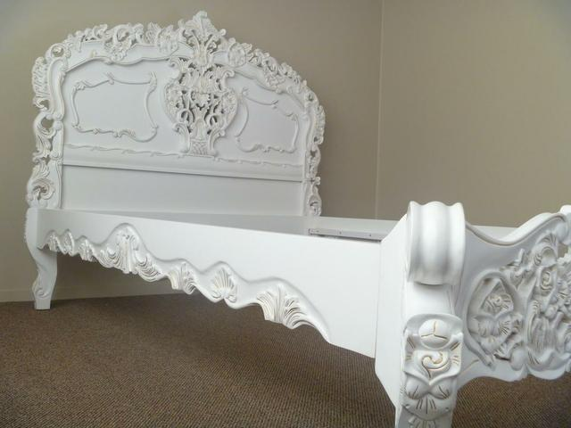Fashion forward in white with delicate gold highlighting, the exquisite looks of the Rococo bed  also showcase the the stunning effect of  deeply carved roses and ribbons ...