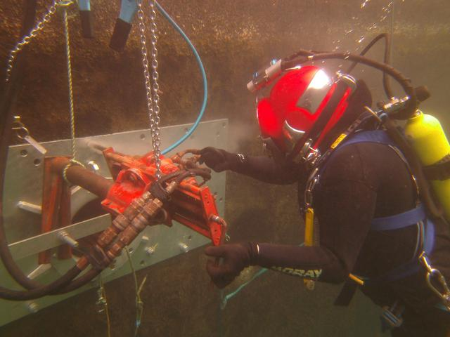 Diver operating a hydraulic core drill