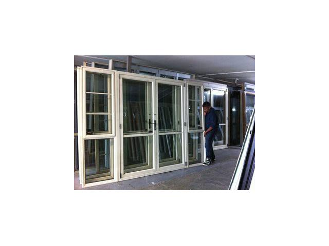 Off White colour aluminium french door with sidelight.It has 2 doors that opens back to the wall and sidelight on either side looking from the out side with 1 opening windows.