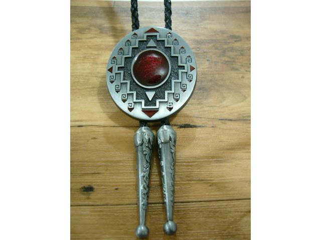 WE SELL BOLO TIES IN MANY DESIGNS FROM ALL OVER THE WORLD
