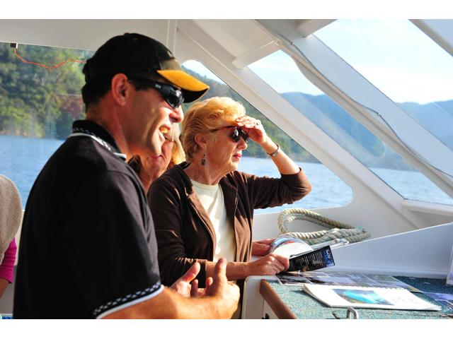 Chatting to guests as we deliver the post to homes through out the Marlborough Sounds on the Magic Mail Boat .