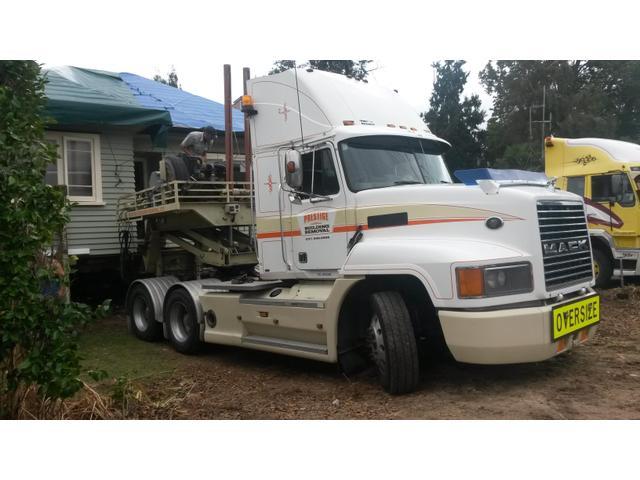 Prestige Building Removal Truck & House