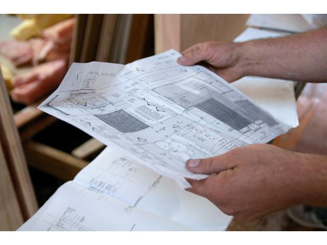Looking over architectural plans onsite, Auckland's leading home renovation experts visit www.havenrenovations.co.nz