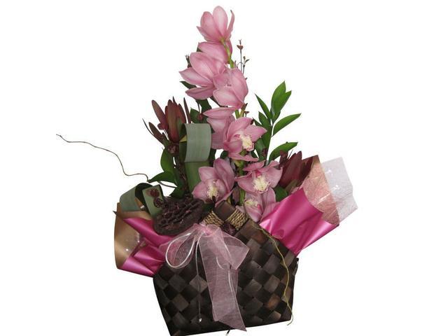 Orchid in kete basket arrangement