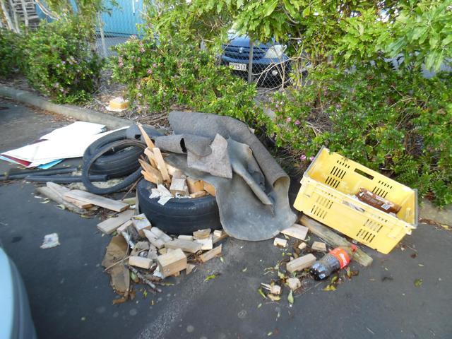 A rubbish strewn car park