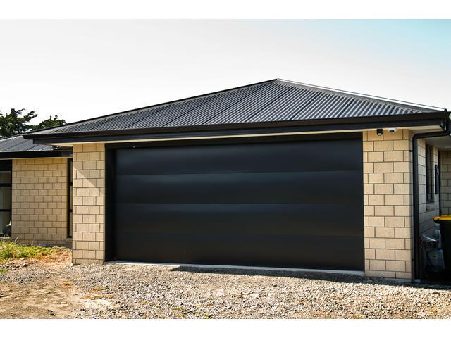 Valero Flat Panel Sectional Door in Pitch Black