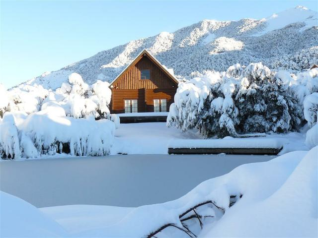 Mt Lyford log chalet village in winter - the perfect base for a ski holiday